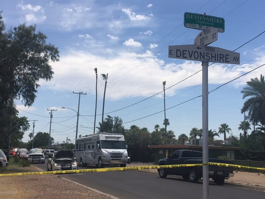 Police respond to a shooting this afternoon near 10th