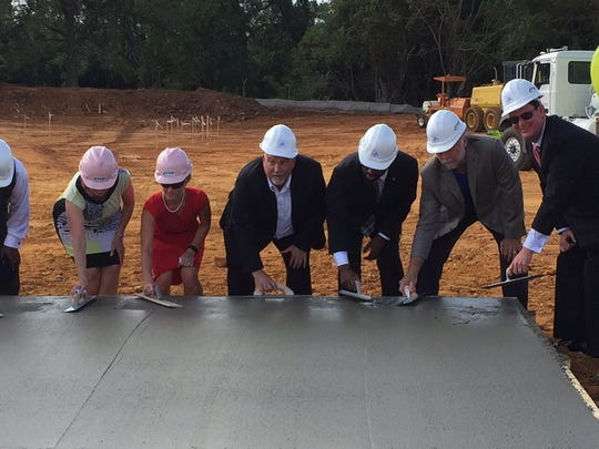 More than 100 onlookers, including city and county commissioners, builders, designers and healthcare partners, saw an already transformed area at the ground-breaking ceremony. Care Point Health and Wellness Center is a one-stop facility for services. Construction is slated to take a year, and the center will open in fall 2017.