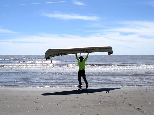 Kris Laurie, at end of his 3,800-mile canoe trip, at Mississippi Delta south of New Orleans.