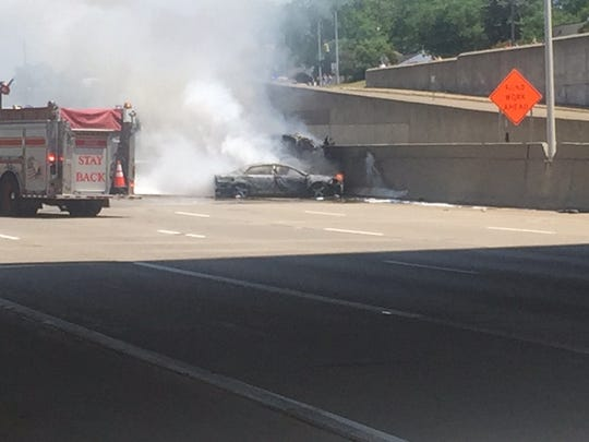 A crash and fire has closed I-696 in Oakland County.
