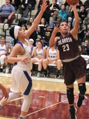 Tularosa's Brynn Martinez, right, attempts a layup