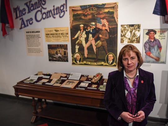 Lisa Budreau, curator of the World War I exhibit, stands