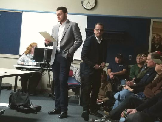 Property owner and developers Chris Houden and Thomas Miller presents during the Jan. 8 Plan Commission meeting in Tosa. They proposed the apartment building, which includes three studio units, 20 one-bedroom units and four two-bedroom units, a leasing office and 34-parking stalls in the lower-level below grade.