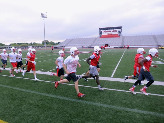 Chippewa Valley players run laps to warm up for a practice earlier this month.