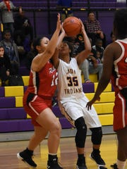 Alexandria Senior High School's Adoria Butler (35) goes up for a shot against  hosted Ruston High School in the first round of the Class 5A playoffs held Thursday, Feb. 14, 2019. Ruston won 61-55 in overtime.