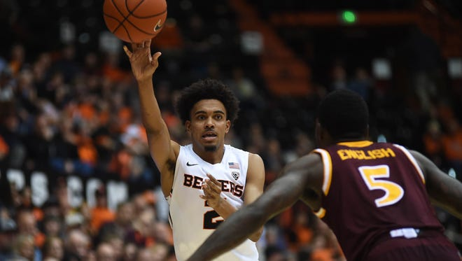 Nov 17, 2015; Corvallis, OR, USA; Oregon State Beavers guard Stephen Thompson Jr. (2) passes the ball while defended by Iona Gaels guard A.J. English (5) at Gill Coliseum.  The Beavers won 93-73. Mandatory Credit: Godofredo Vasquez-USA TODAY Sports