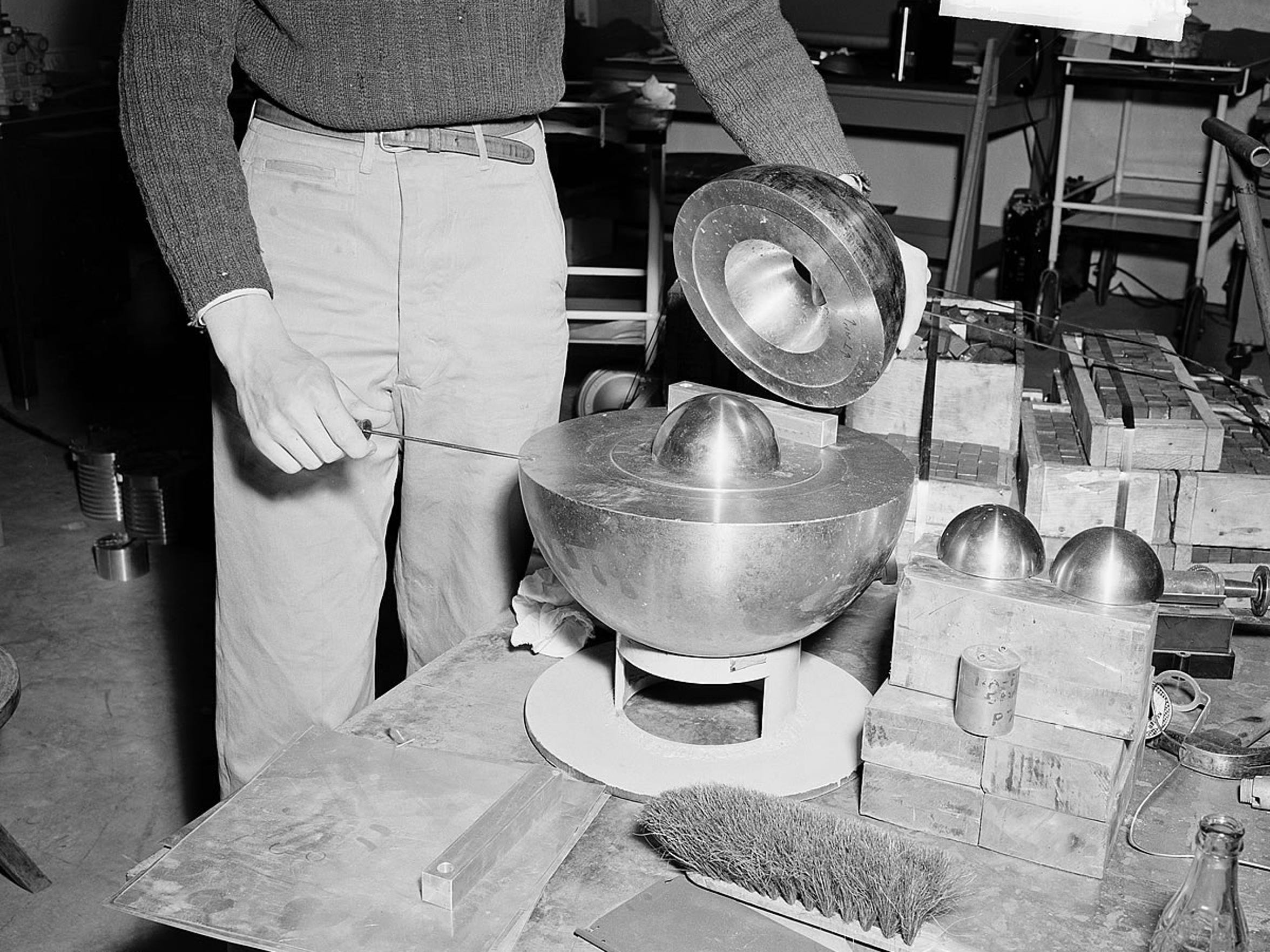 Los Alamos scientist Louis Slotin held the two halves of the core apart with a screwdriver. It slipped, killing him.
