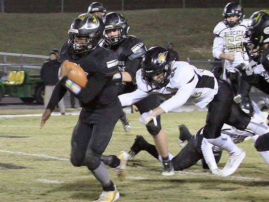 Fairview running back #8 Darius James out runs the