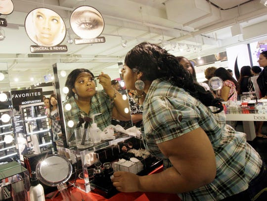 Customers try on makeup before they buy at Sephora