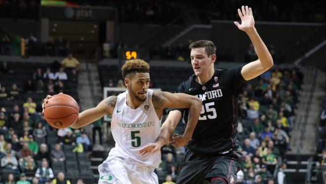 Jan 10, 2016; Eugene, OR, USA; Stanford Cardinal forward Rosco Allen (25) defends as Oregon Ducks guard Tyler Dorsey (5) dribbles the ball at Matthew Knight Arena. Mandatory Credit: Scott Olmos-USA TODAY Sports