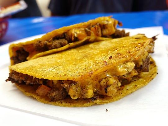 Mar y tierra tacos with shrimp, carne asada and chipotle sauce at Sr. Ozzy's Tacos y Mariscos in Phoenix.