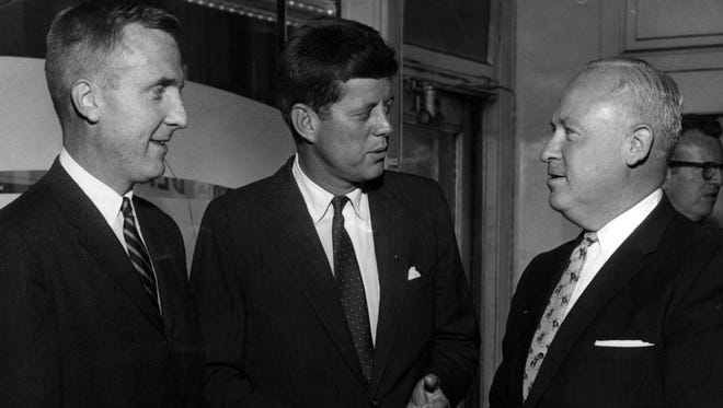 John F. Kennedy, one year before he would be elected president, visits the opening of the new Democratic Party headquarters. At left is Cincinnatian John J. Gilligan, a future Ohio governor.