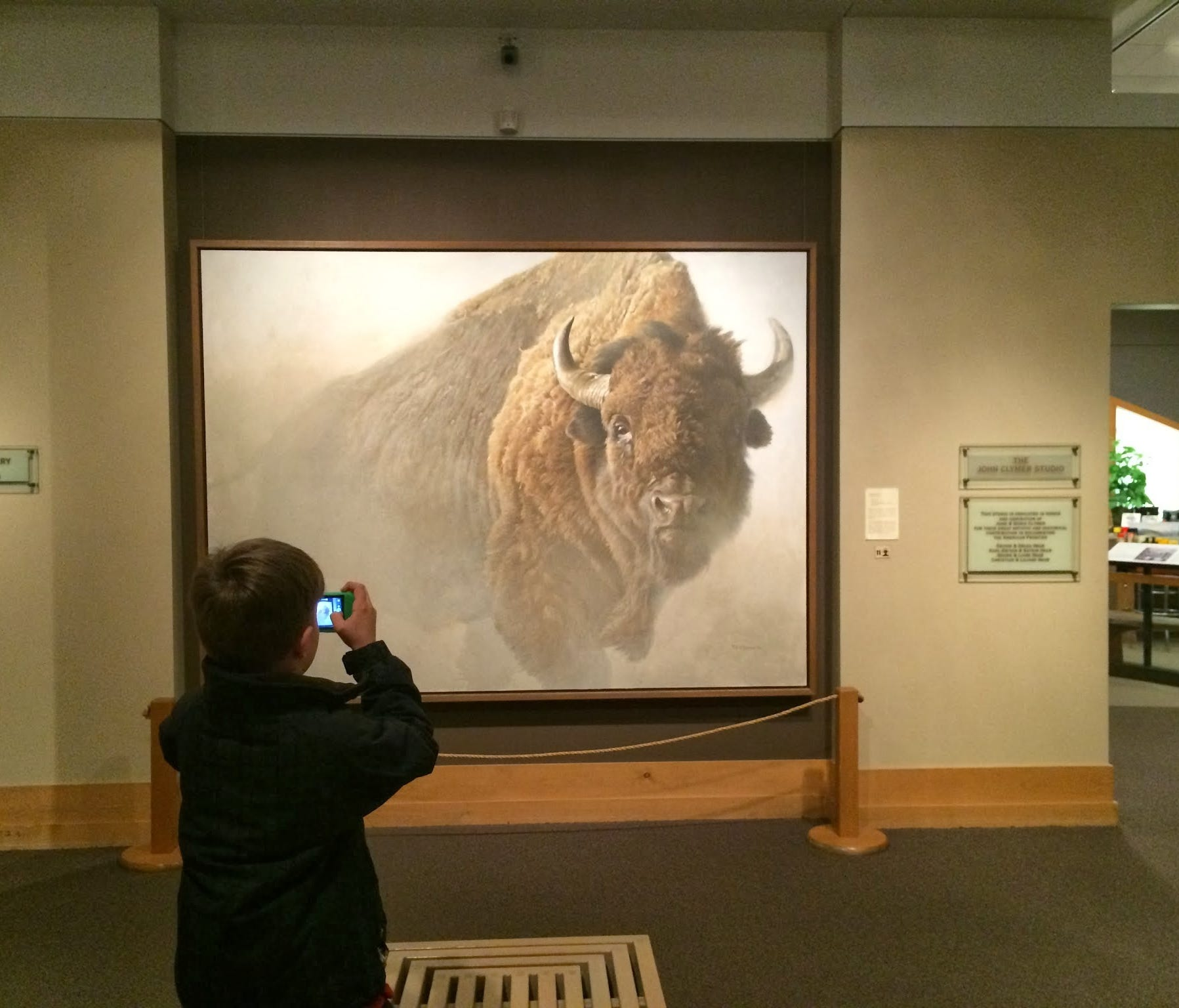 Iden Elliott photographs a painting at the National Museum of Wildlife Art in Jackson Hole, Wyo. A two-week trip to the American West helped us get acclimated to a life lived on the road.