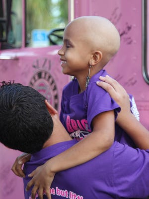 Amiyah, who was diagnosed less than two months ago, receives some affection from Darrian McClure, 12, during the run.
