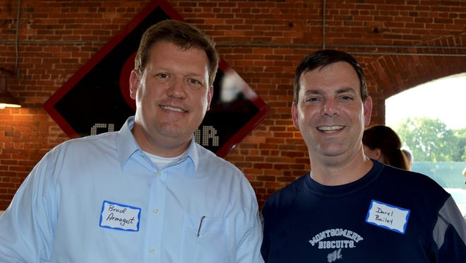 Brad Armagost, left, and Daryl Bailey were among those at a celebration for the Family Sunshine Center's Making Homes Safe Havens' benefit.