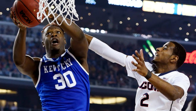 UK forward Julius Randle shoots against Connecticut forward DeAndre Daniels in the second half during the championship game.