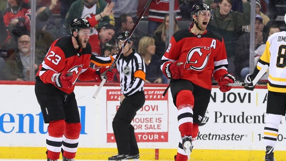 New Jersey Devils center Travis Zajac (19) and New