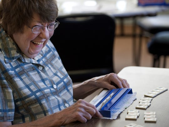 Agnes Bruce is all smiles after laying down all but three of her tiles during a round of Rummikub Tuesday afternoon.