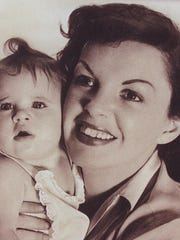 The legendary Judy Garland is shown with her baby daughter,