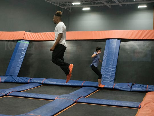 Trampoline exercise instructor Deshaun White demonstrates