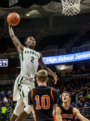 New Haven's Eric Williams Jr. dunks the ball during an MHSAA Class B state basketball final against Ludington Saturday, March 25, 2017 at Michigan State University.