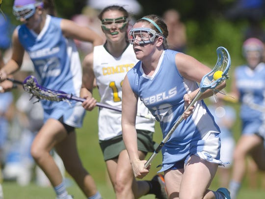 South Burlington's Casey Johnson, right, charges up the field in transition during a high school girls lacrosse game last season.