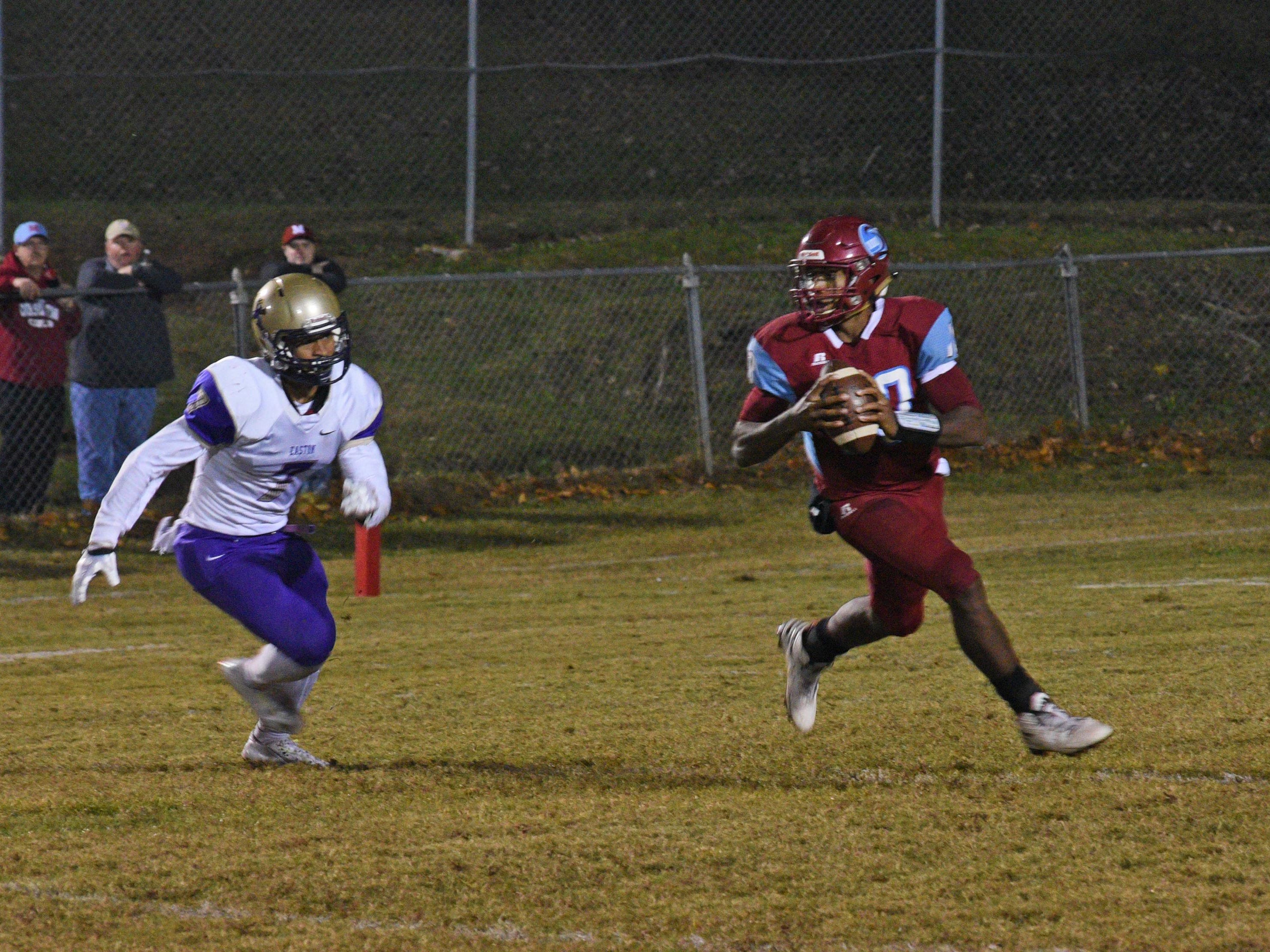 Minden's Antonio Rivette looks for a receiver down field against Warren Easton in a third-round Class 4A playoff game Friday night.