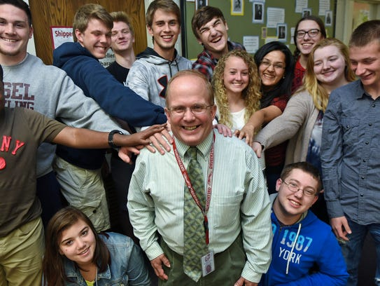 Principal Bruce Levy, center,  hangs out with students
