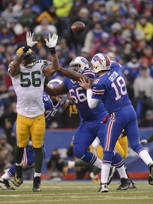 Green Bay Packers linebacker Julius Peppers (56) pressures Buffalo Bills quarterback Kyle Orton (18) in the third quarter during Sunday's game at Ralph Wilson Stadium in Orchard Park, New York.