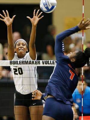 Danielle Cuttino tries to turn back a kill attempt by Naya Crittenden of Illinois Wednesday, September 21, 2016, in Holloway Gymnasium on the campus of Purdue University. Illinois upset No. 10 Purdue 21-25, 25-20, 25-23, 25-27, 15-11.
