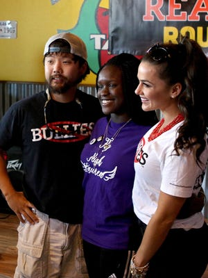 """James Huling (left) and Natalie Negrotti (right) pose with Makayla Smith at the first Reality Roundup at Fuzzy's Taco Shop in 2016. Huling, of Wichita Falls, and Negrotti met while competing on """"Big Brother"""" 18. Auditions for """"Big Brother"""" are slated for April 22 at Patterson Kia."""