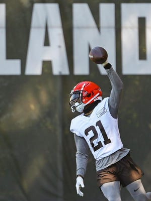 Browns cornerback Denzel Ward celebrates after picking off a pass intended for wide receiver KhaDarel Hodge during practice Thursday, Aug. 20, 2020, in Berea, Ohio.