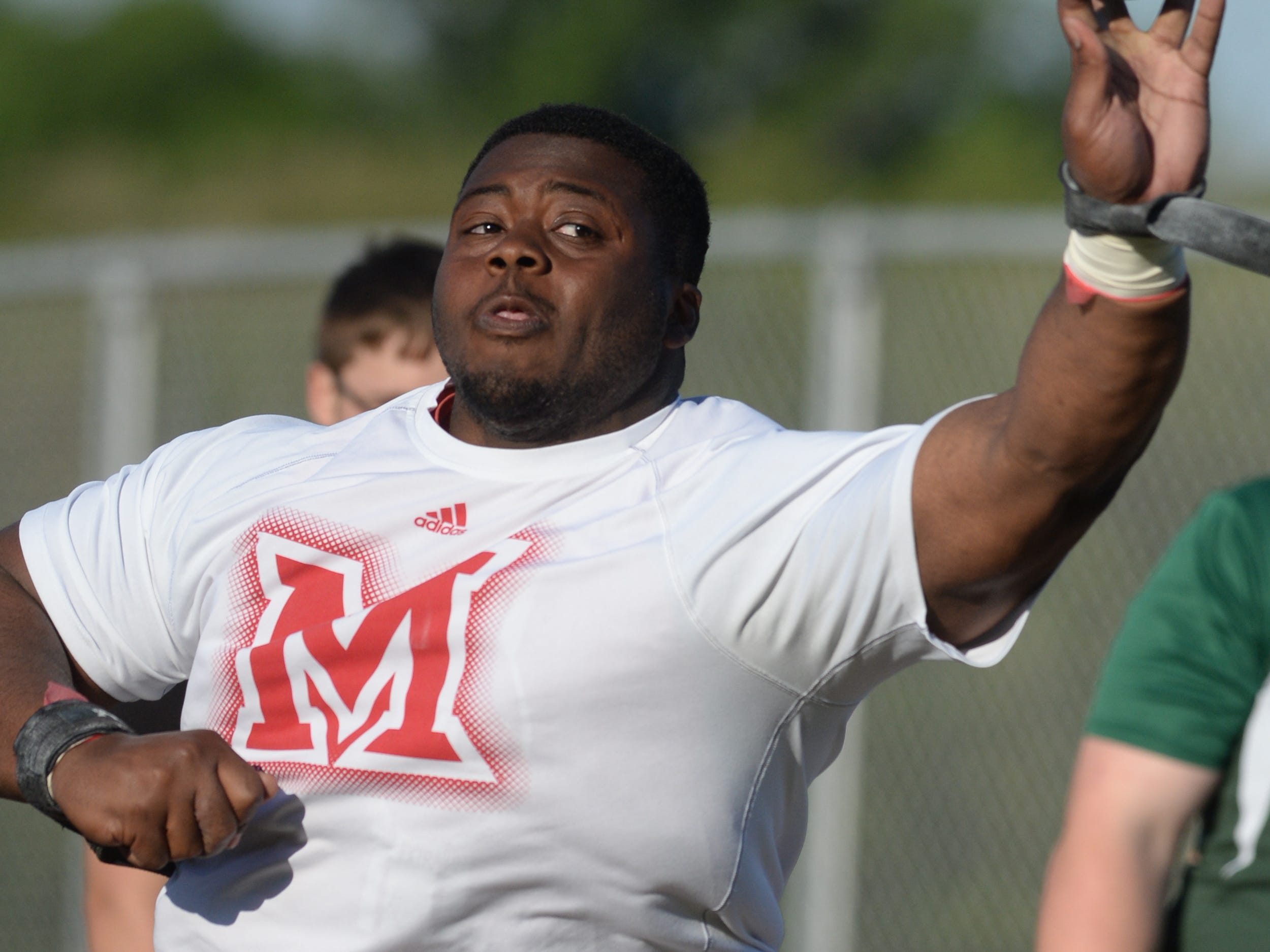 Richmond's Nathon Trawick warms up in shot put during the track and field sectional Thursday, May 21, 2015, at Connersville.