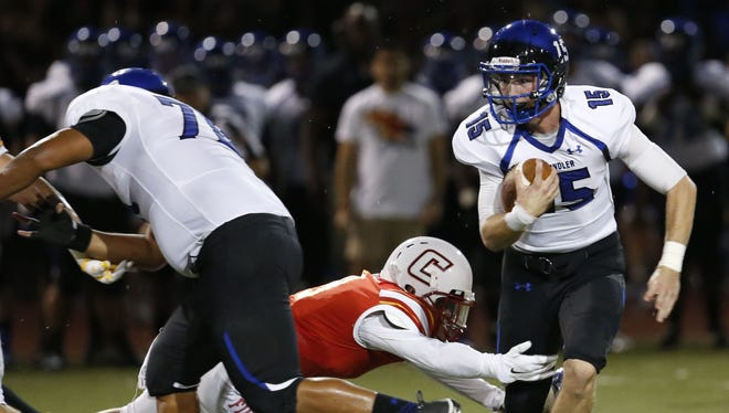 Chaparral Jack Moyes attempts to tackle Chandler quarterback Mason Moran during a high school football game at Chaparral in Scottsdale on Friday, September 4, 2015. #hsfb