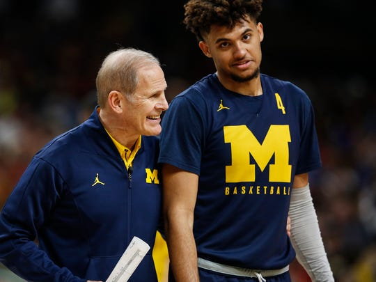 Michigan head coach John Beilein talks to forward Isaiah Livers during practice at the Alamodome in San Antonio, Texas, Friday, March 30, 2018.