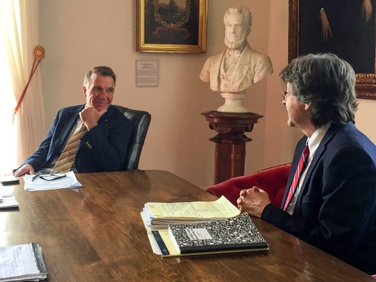 Gov. Phil Scott meets with administration economist Jeffrey Carr, right, on June 12, 2018 to discuss tax revenue that exceeds expectations by about $11 million. Scott pointed to the revenue as one reason he would reject any possible tax increase.