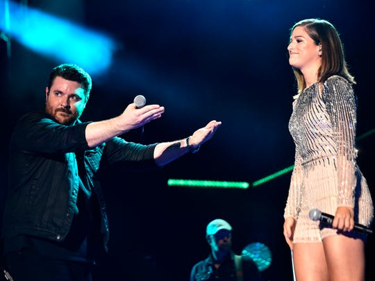 Chris Young performs with Cassadee Pope during the
