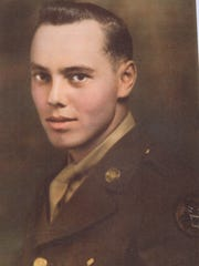 """Color portrait of Pvt. Delmas """"Dev"""" Devenger prior to transferring from the Tank Destroyers to the 10th Mountain Division. Born in Danville, Devenger was killed in action."""