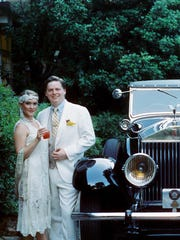 From left, Georgiana Hunt, Mitchell Clemmons and Miller Clemmons pose with a vintage Rolls Royce at the Fitzgerald Museum.