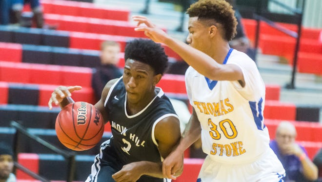 Snow Hill guard Ameer Fisher (3) drives in the paint against Thomas Stone on Tuesday, December 29th at James M Bennett High School as part of the Governor's Challenge.