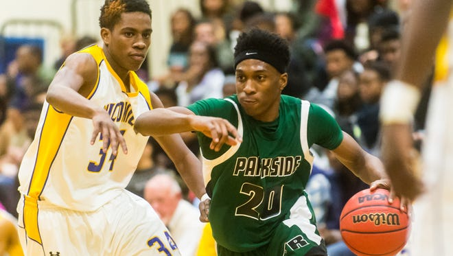 Parkside guard Gary Briddell (20) battles to the basket against Wicomico  on Tuesday, January 5th in the WallerDome at Wicomico High.