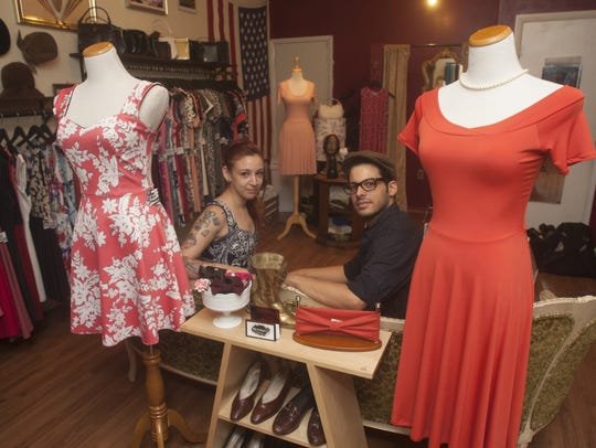 Surrounded by dresses she designed, Arielle Salkowitz