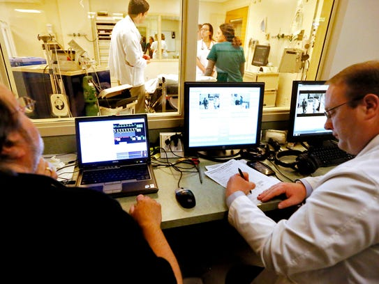 Medical Simulation Technician Paul Schreck, left, and