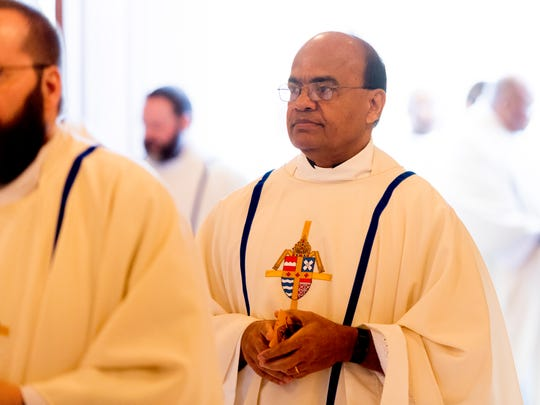 A processional member at the Mass and Rite of Dedication of the Cathedral of the Most Sacred Heart of Jesus in Knoxville, Tennessee on Friday, January 1, 2016. After nearly three years of construction, the 28,000-square-foot domed cathedral opened to a noon mass attended by more than 1,000 people.