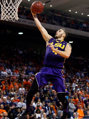 LSU Tigers guard Keith Hornsby (4) makes a layup against the Auburn Tigers during the first half at Auburn Arena.  LSU beat Auburn 80-68.