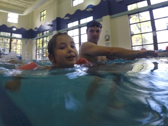 """ANI Swim Clinic Wesley Watkins (back), a triathlete, watches a young Wild Kidz Tri participant as she makes her way in the pool during a """"Swim + Transition Tips Clinic"""" held Saturday, Aug.15, 2015 at the Louisiana Athletic Club in Pineville. Children regis"""