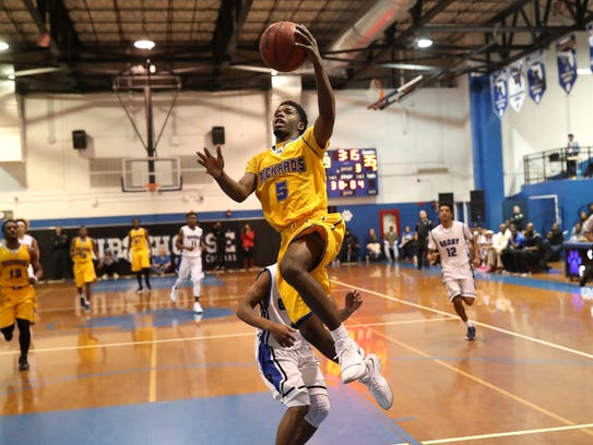Rickards' Vincent McCray lays the ball up on a fast