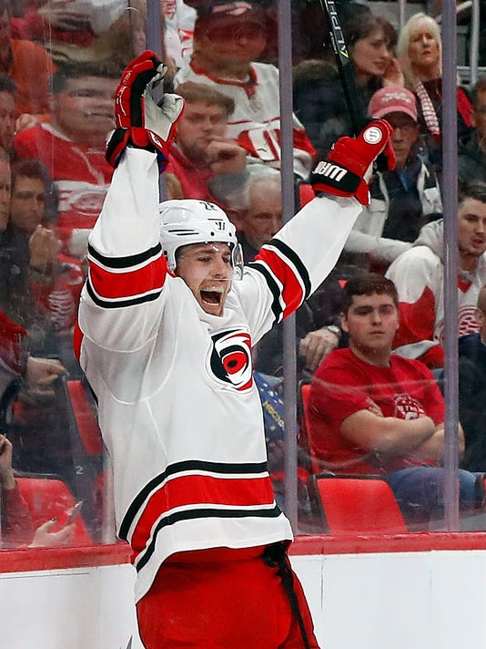 Carolina Hurricanes center Elias Lindholm (28) celebrates his goal against the Detroit Red Wings in the third period of an NHL hockey game Saturday, Jan. 20, 2018, in Detroit. (AP Photo/Paul Sancya)