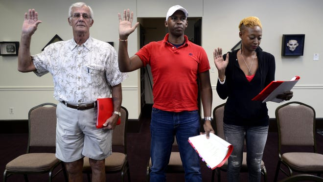 """Veterans, from left, Patrick McCrary, Timothy Jones and Tabitha Nichols rehearse lines from """"Telling: Pensacola"""" recently at Pensacola Little Theatre. The stage performance is part of the national Telling Project that features area veterans and military family members telling their stories of life in and out of the military. The project started in 2015 in Tampa with the mission of increasing community understanding of veterans' experiences, injuries and challenges they've had to overcome while transitioning back into civilian life."""