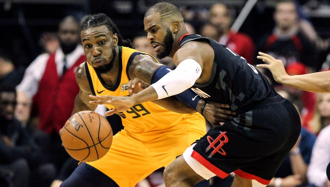 Utah Jazz forward Jae Crowder, left, attempts to get the ball away from Houston Rockets guard Chris Paul during the second quarter in game one of the second round of the 2018 NBA Playoffs at Toyota Center.
